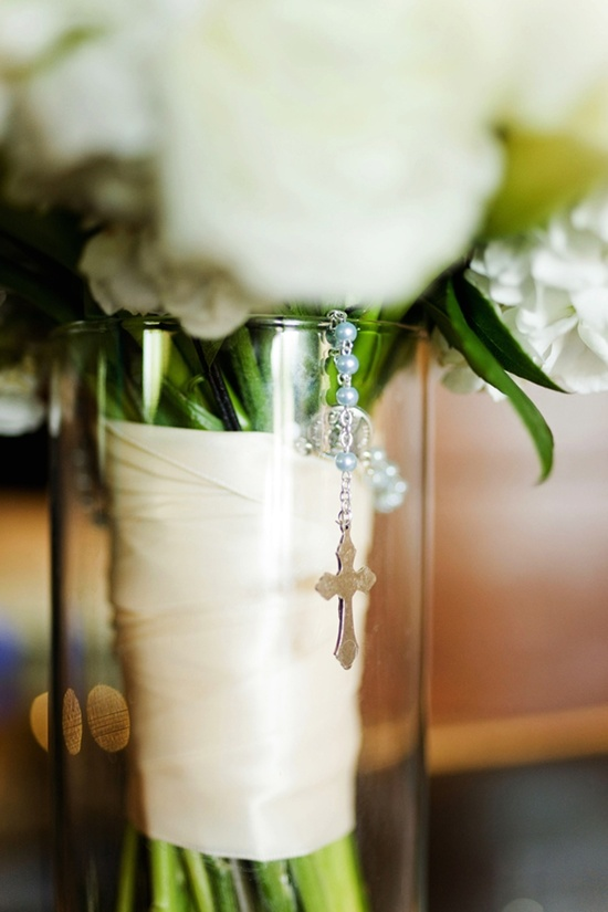 white bridal bouquet with rosary