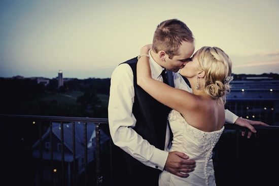 bride groom kiss at end of wedding reception night