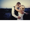 Bride-groom-kiss-at-end-of-wedding-reception-night.square