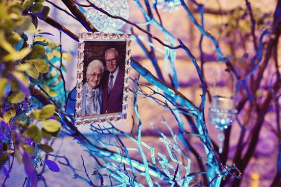 real wedding inspiration manzanita branch centerpieces honoring grandparents with photos