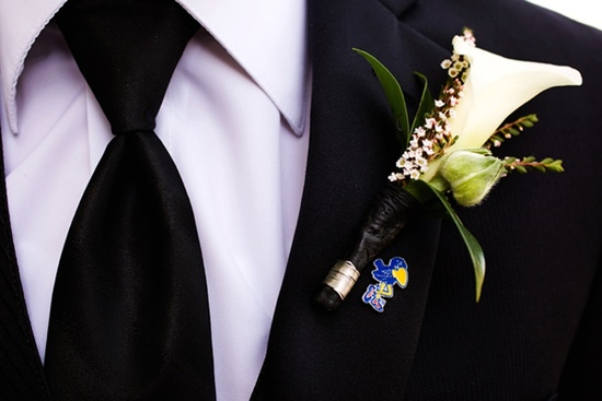 classic grooms attire black tux ivory tie bout
