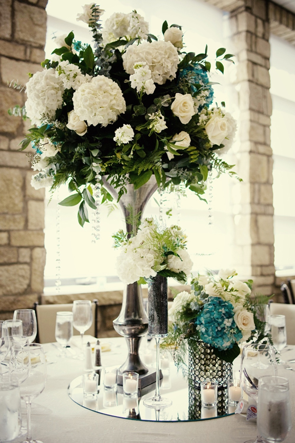 elegant wedding reception centerpieces ivory hydrangeas teal accents