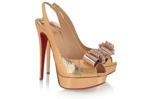 photo of Christian Louboutin gold platform wedding shoes