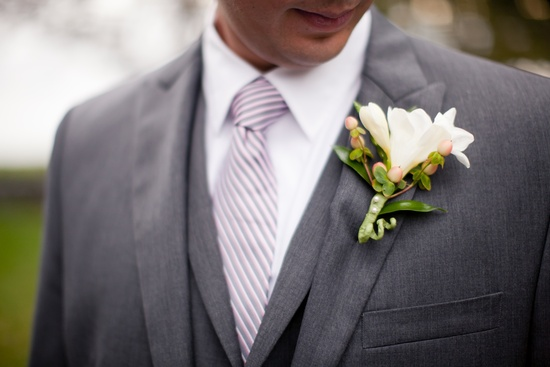 photo of handsome grooms attire charcoal gray suit white bout