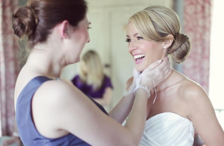 Wedding-hair-inspiration-sleek-bridal-bun.full