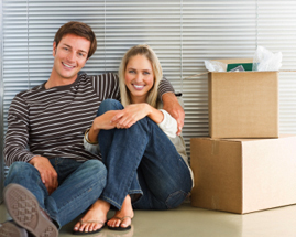 Cohabitation happy young couple by boxes
