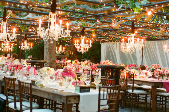 hot pink wedding reception table outdoor chandeliers