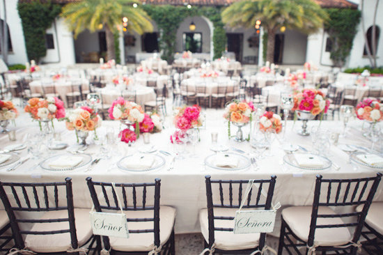 beach wedding bright wedding color palette pink outdoor reception tablescape