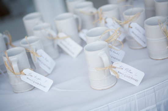 photo of unique wedding favors coffee mugs tied with thanks