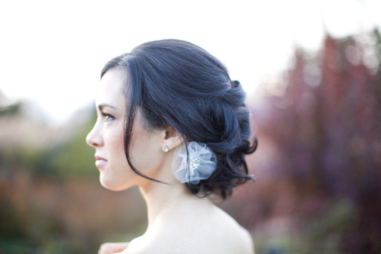 loose bridal updo low chignon flower wedding hair accessory