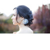 Loose-bridal-updo-low-chignon-flower-wedding-hair-accessory.square