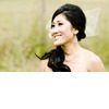 Asian-bride-wears-loose-side-ponytail-net-veil-bow.square