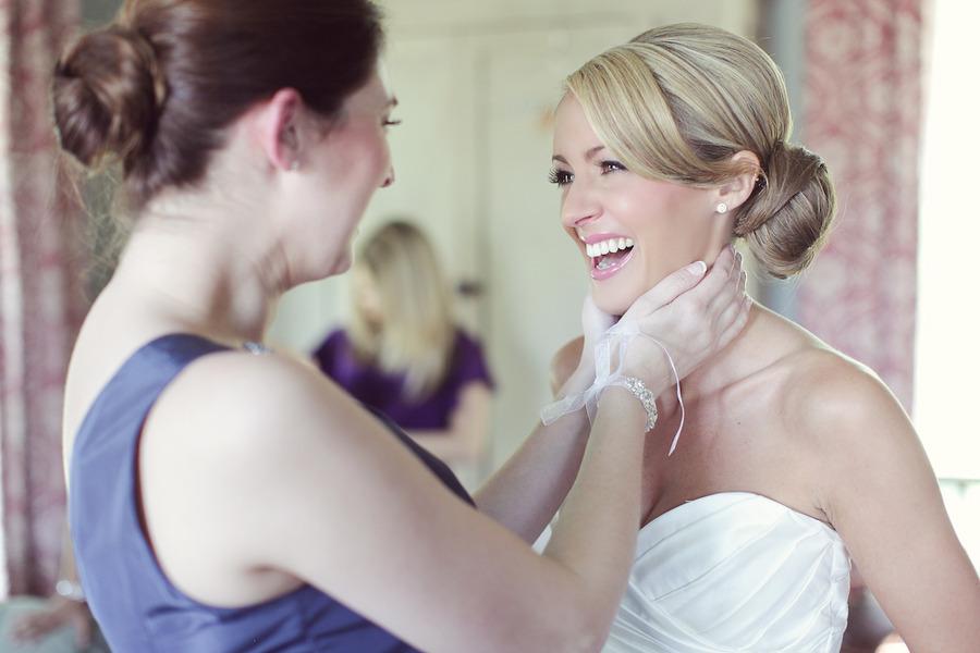 Sleek-bridal-bun-sweetheart-wedding-dress.full