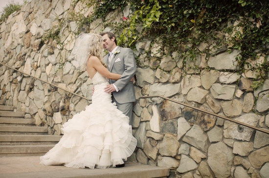 bride wears mermaid wedding dress kisses groom