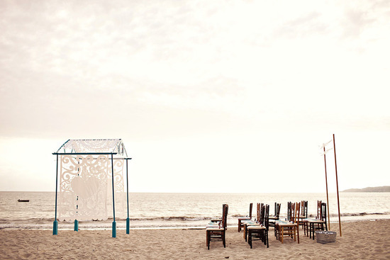 photo of elegant beach wedding ceremony setup