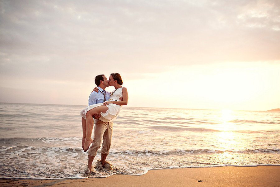 destination wedding on beach bride groom kiss