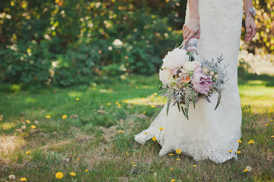 romantic bride holds vintage inspired bridal bouquet