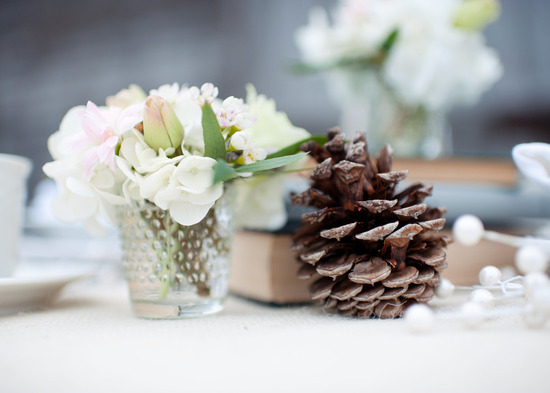 photo of rustic winter wedding reception tabletop centerpiece
