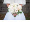 Winter-bride-wears-fur-shrug-holds-ivory-light-pink-bridal-bouquet.square