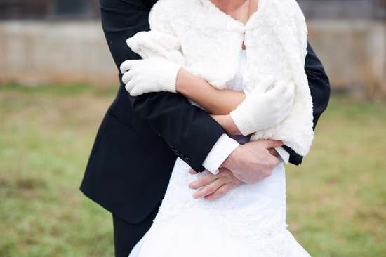photo of winter wedding bride groom embrace