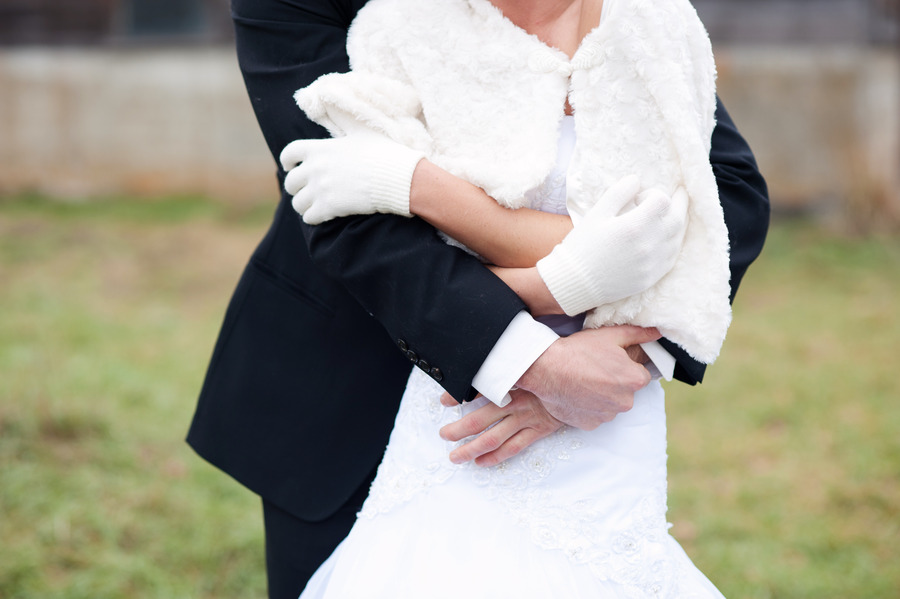 Winter-wedding-bride-groom-embrace.original