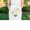 Bride-wears-lace-wedding-dress-holds-romantic-bridal-bouquet.square