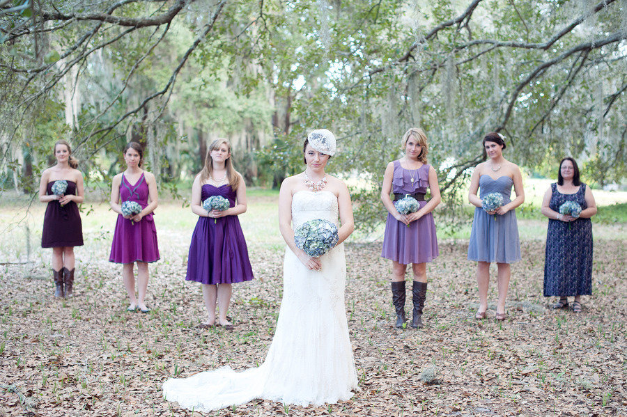 _bride-poses-with-mix-and-match-bridesmaids-some-in-cowboy-boots.full