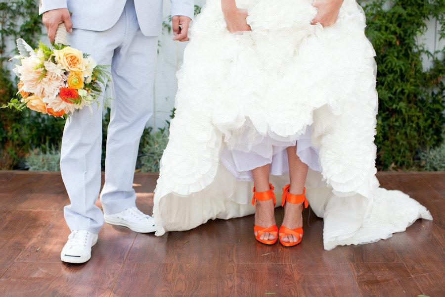 Bride-wears-white-wedding-dress-hot-orange-heels.full