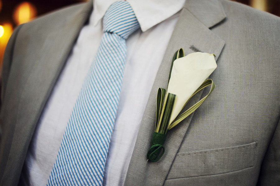 groom wears grey suit blue white seersucker tie
