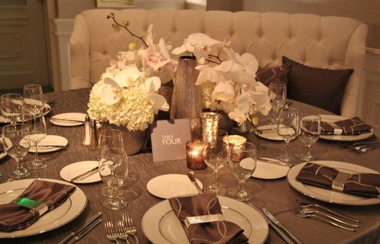 photo of neutral wedding color palette ivory hydrangea white orchid wedding flowers