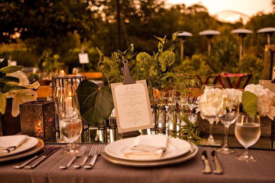 Elegant outdoor wedding reception greenery as table decor for Table design for wedding