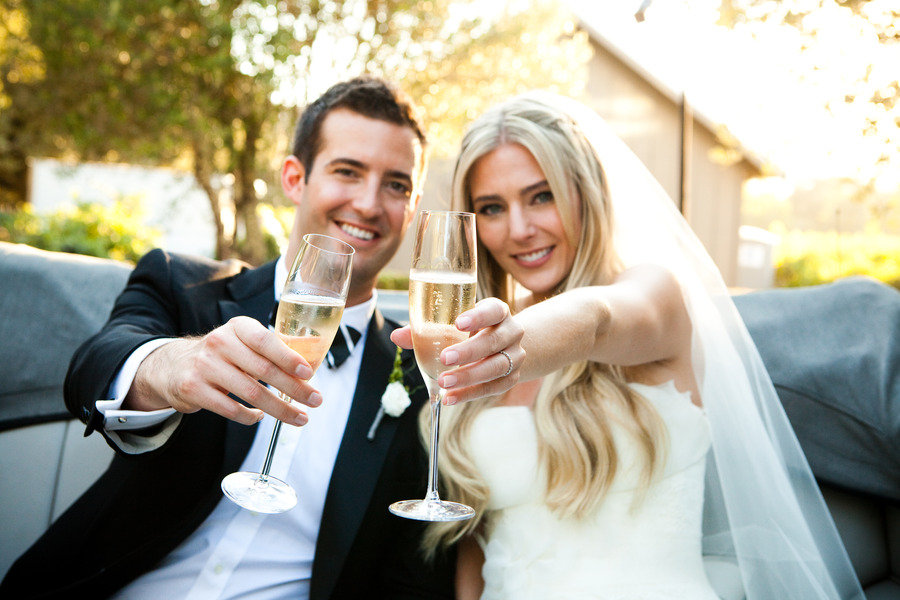 Bride-groom-toast-with-champagne-black-tie-outdoor-reception.original