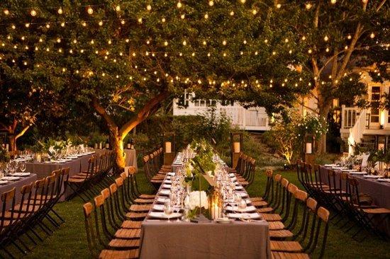 photo of romantic outdoor wedding reception enchanted garden
