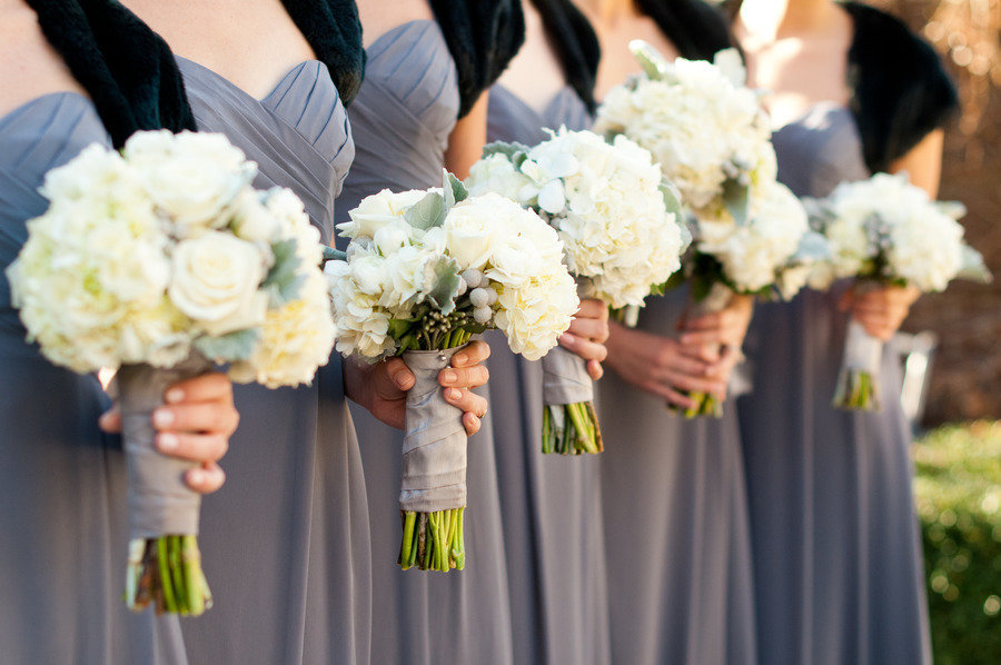 bridesmaids wear grey dresses black shrugs ivory wedding flowers