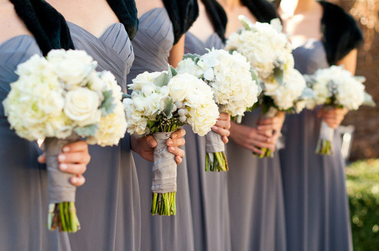 photo of bridesmaids wear grey dresses black shrugs ivory wedding flowers bouquets