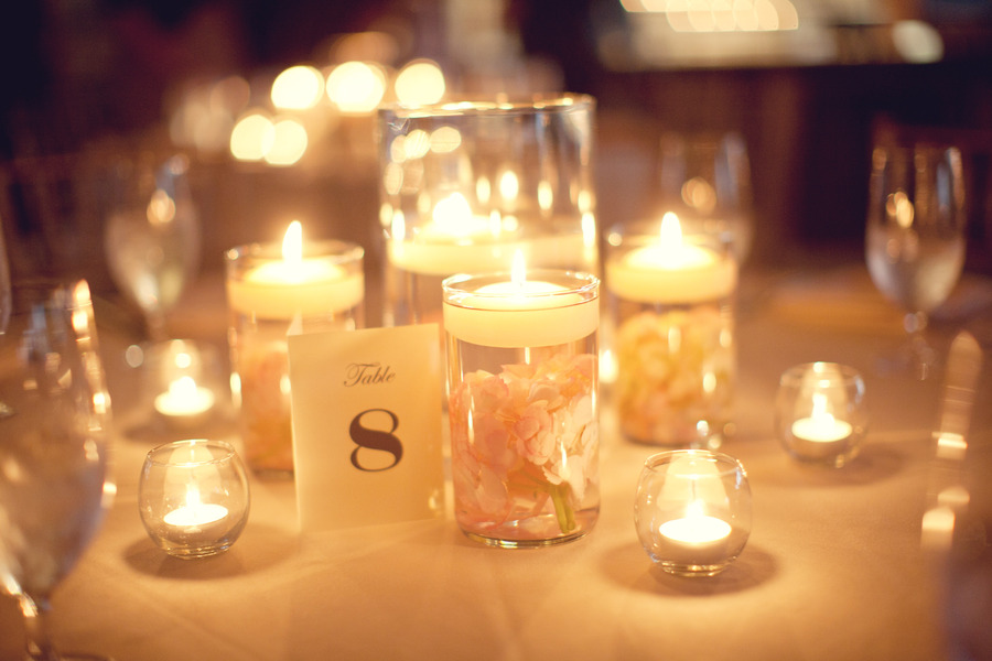 romantic wedding reception table hurricane vases candles | OneWed.com