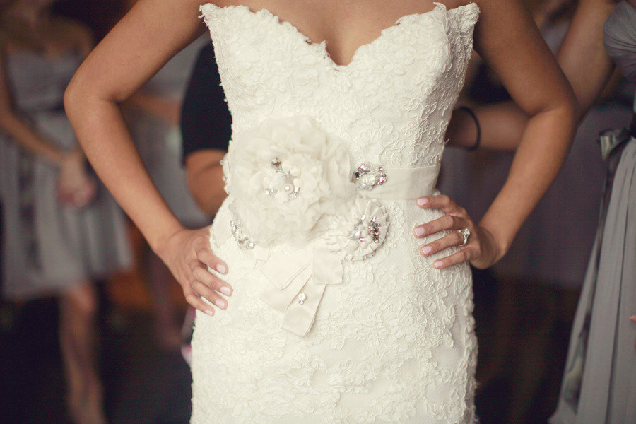 Bride wears ivory lace wedding dress embellished bridal for Ivory wedding dress sash