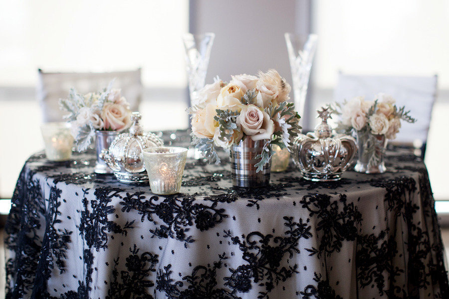Elegant-wedding-tablescape-black-lace-overlay-silver-vases-candles.full