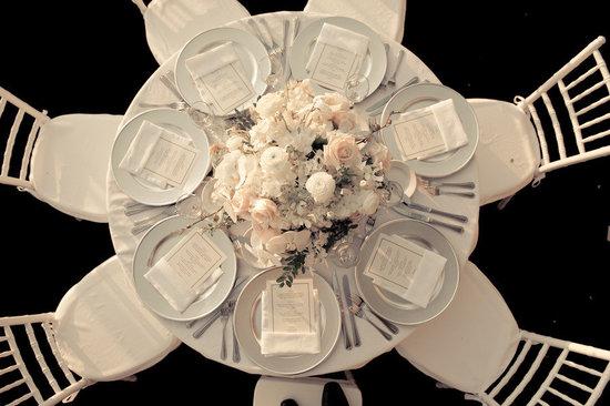 photo of elegant wedding reception venue ivory blush nude wedding flower centerpiece