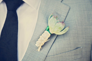 photo of Handsome grooms wearing tuxes and suits, elegant boutonnieres
