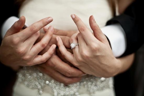 photo of artistic wedding photography diamond engagement ring shot