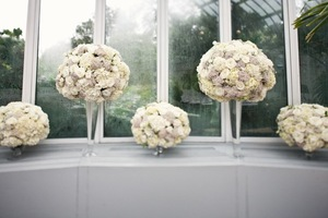 photo of romantic wedding reception flowers topiary centerpieces