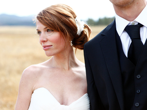 photo of redhead bride sleek wedding hairstyle chignon