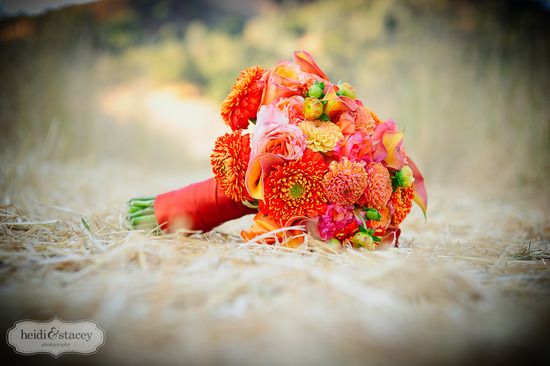 Bright orange bridal bouquet for spring or summer wedding