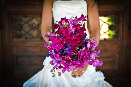 Bright bridal bouquet with fuchsia purple orchids