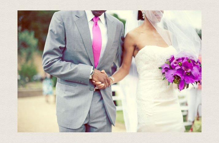 Groom-in-grey-suit-hot-pink-tie-bride-wears-white-lace-wedding-dress.full