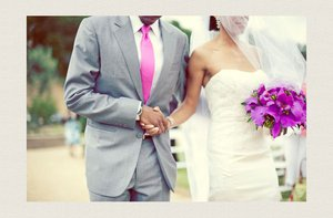 photo of groom in grey suit hot pink tie bride wears white lace wedding dress