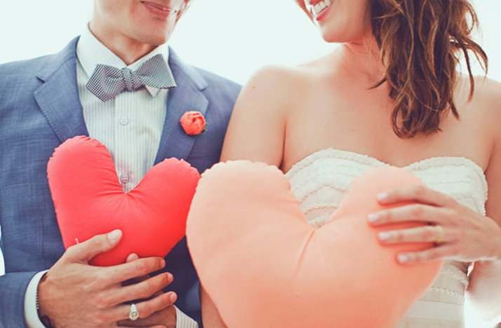 Valentines-themed-wedding-photos-bride-groom-hold-hearts-diy.full