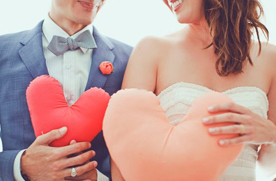 valentines themed wedding photos bride groom hold hearts DIY