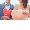Valentines-themed-wedding-photos-bride-groom-hold-hearts-diy.square
